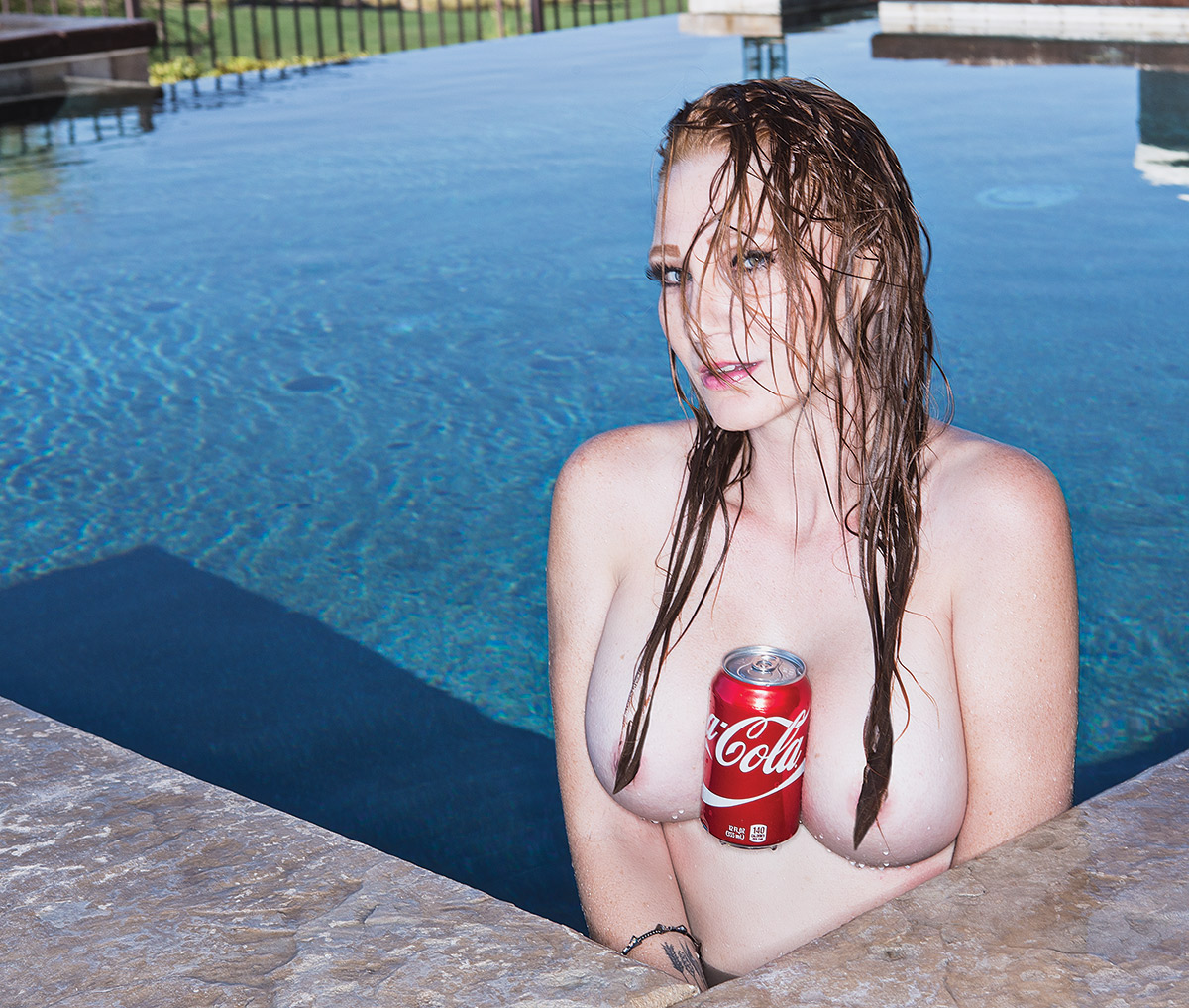 Hold a coke with your breasts